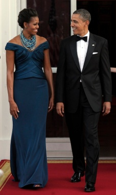 President Barack Obama and first lady Michelle Obama welcome Britain's Prime Minister David Cameron, Wednesday, March 14, 2012, in Washington. (AP Photo/Susan Walsh)