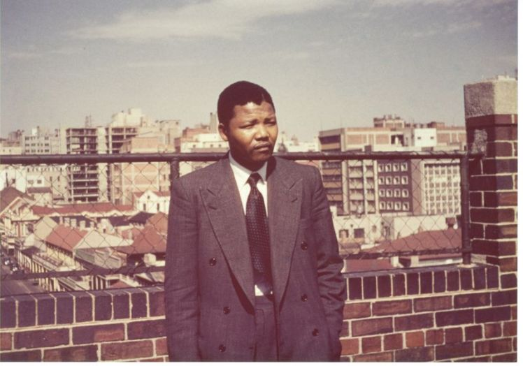 Culled from nelsonmandela.org: Nelson Mandela on the roof of Kholvad House in 1953. Image courtesy of the Ahmed Kathrada Foundation